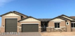 Gorgeous New home with RV garage, paver driveway, charming courtyard and stone accents.