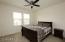 Bedroom 2 overlooks front yard & has ceiling fan.