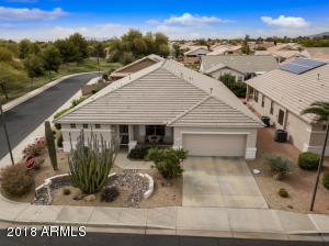 Located in the guard-gated over 55 community of Arizona Traditions, this lovely 2321sf Phoenician model is nestled on an open corner lot with views to the greenbelt and Great Eagle Golf Course!