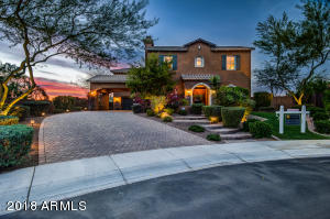 Perched on an elevated 1/2+ acre lot, this home exudes luxury.