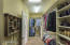 No shortage of shelving, hangar and shoe storage space in this extra large walk-in closet