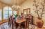 Formal dining area light and bright with lots of windows and plantation shutters!