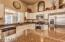 Newly refinished cabinets, beautiful quartz counters and stainless steel appliances.