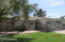 Front on large lot, lots of landscaping, paver walks and covered patio and accent stone