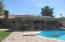 Humongous Back Covered patio with diving pool, BBQ, firepit, GAZEBO, grass, and lots of seating area in paver patio.