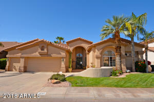 Beautiful single level home, 3 car garage, mature well groomed landscaping and fountain.
