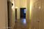 corridor to enter a laundry room & all bedrooms