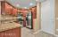 Kitchen With Upgraded Cabinetry And Granite Countertop
