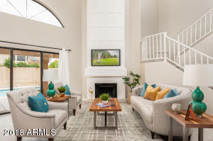 CUSTOM MILL-WORK FIREPLACE W/SOARING VALUTED CEILING!