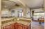 Separate bar area between dining room and kitchen is perfect for entertaining!