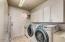 Indoor laundry offers tons of storage and a utility sink.