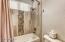 Hall bath custom shower surround.