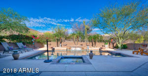 Features fountains cascading into the heated pool & spa, kiva fireplace and built-in BBQ