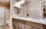 White marble tops w custom backsplash. Tile flooring, ash cabinets, brushed nickel fixtures.