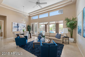 The living room overlooks the backyard and provides easy assess to the pool.