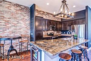 The island expansion was done in the remodel, gorgeous granite slab used!
