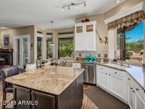Upgraded kitchen is light and bright and has been upgraded with stainless appliances, slab granite counters, and stone backsplash.