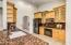 Kitchen with granite countertops & black appliances