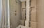 Custom Shower with bench, soap inlets, rain type shower head.