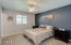 Master bedroom features new paint with accent wall, two inch blinds, brand new carpeting.