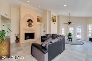 """Real wood burning fireplace with a deep pit to bring warmth and beauty. The water feature above mantel brings relaxing and calm sounds. Truly a """"Great"""" room."""