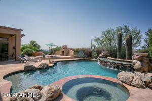 Spa View to Pool's Water Feature, Gas Fireplace and Raised Seating Area