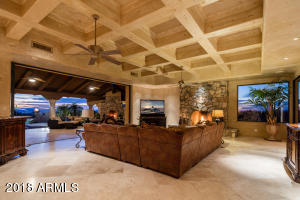 Simply fabulous! The wall of glass opens to bring the outside in...note the coffered ceiling detail