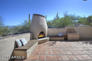 Views of over sized patio! Wonderful Kiva Fireplace! Lots of outdoor living. No neighbor to the East! Great NOAS buffer.