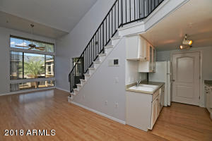 Main Living room with view of stairs to loft and kitchen