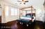 Ground-level master bedroom retreat, updated with wood flooring, shutters, upgraded baseboards & custom barn door to Bathroom