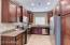 Kitchen with beautiful cabs, granite counter top and cherry cabs.