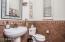 Half-bath near flex room. Look at the tile work!!
