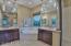 Dual vanities, large soak tub, glass shower, and walk-in closet