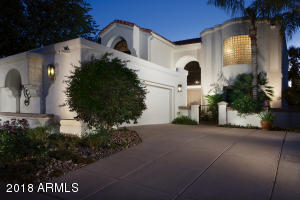 Smooth stucco finish and grassy front yard.
