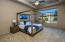 The large master bedroom over looks the breath taking pool.