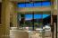 The special colors of dusk are easily evident through the Walls of Glass in the home.