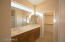 Master bathroom with dual sinks, walk-in shower and water closet