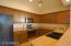 Spacious kitchen with black appliances