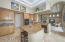 Kitchen island, double ovens, flat cooktop, and walk-in pantry