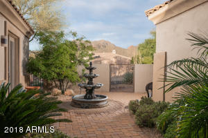 A lovely gated front courtyard with views of the McDowell Mountains.