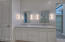 Carrara marble slab counter, note the huge custom framed mirror in the closet on the right