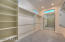 Lavish master closet, with custom mirror, lots of custom hanging and closet space