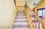 Staircase to Upper Level Bedrooms features large storage closet underneath!