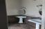 Owners suite bathroom with separate pedi stool sinks.