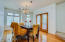 Spacious formal dining room with beautiful wood floors and patio access.