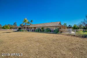 Front of ranch with pasture in front & orchard to the right