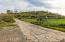 Horse set up is flat and loaded with finishes! 3 stall mare motel, water, split rail fencing, tack shed, and no climb fencing on the turn out! Note CONCRETE road from bottom to the top paved courtyard. This Estate is a diamond.