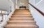WIDE STAIRCASE LEADING TO UPSTAIRS BEDROOMS/BATHROOMS