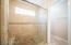 Master bath shower - travertine tile and pebble floor