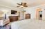 This spacious room offers crown molding and a ceiling fan for comfort.